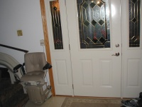 This is the front door.  Visible on the left is the actual stair lift.  It's battery powered, and charges at the ends.  The front door was replaced several years ago.