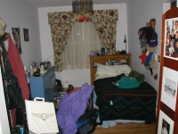 This is a picture of my dad's bedroom, formerly the dining room.  The divider on the right is filled with pictures.