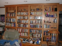 The bookshelf.  All sorts of sci-fi, fantasy, textbooks, and assorted reading.