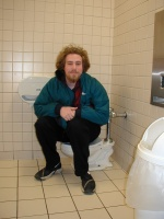 Russ, sitting on the mini-me toilet.  Also known as a kid's toilet.