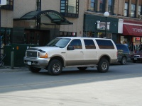 An obscenely large Ford Excursion in downtown Iowa City.  Prarie Lights (a nice bookstore) is in the background, as is Micky's.