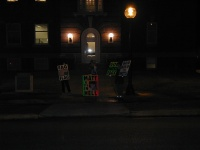 "The GodHatesFags crew out holding their signs protesting the ""Laramie Project"" play at Cornell College."