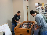Tony, Bravo, and Aubry playing Foosball.