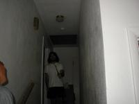 Don down a hallway.