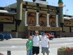 Russ, Alan, and Dennis standing outside the corn palace.