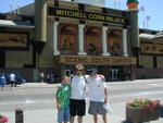 Russ, Alan, and Dennis standing outside the corn palace, again.